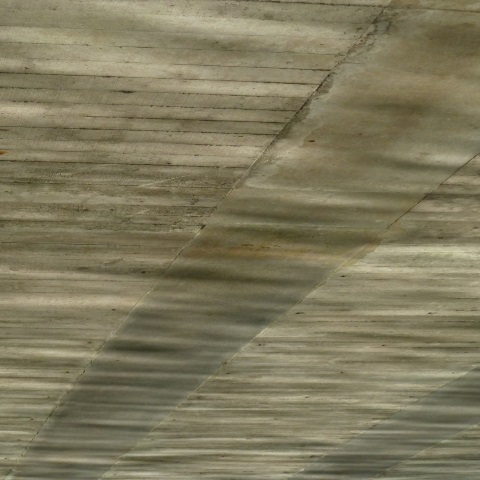 t00456: abstract photo (reflections on underside of bridge) by Ewart Shaw