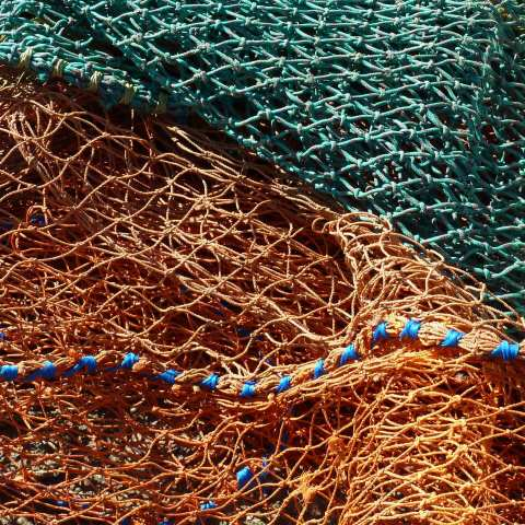 t00782: abstract photo (fishing nets on quayside) by Ewart Shaw